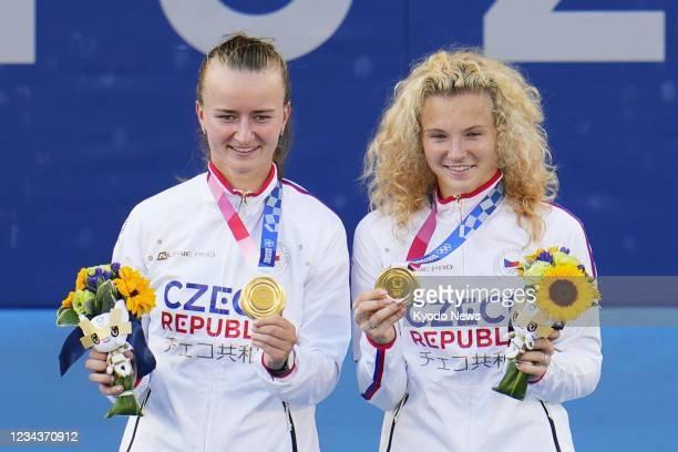 Barbora Krejcikova and Katerina Siniakova of Czech Republic pose with their gold medals after upsetting Belinda Bencic and Viktorija Golubic of...