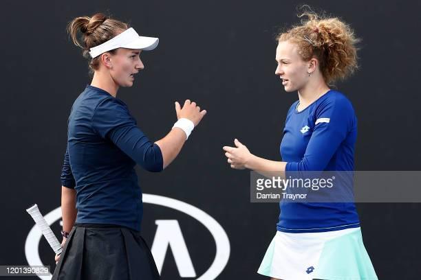 Barbora Krejcikova and Katerina Siniakova of Czech Republic talk tactics during their Women's Doubles first round match against Anna-Lena Friedsam...