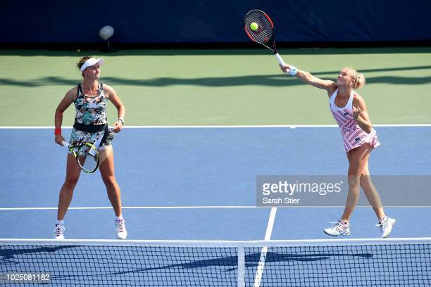 Barbora Krejcikova and Katerina Siniakova of The Czech Republic compete in their women's singles first round match against Kateryna Bondarenko of...