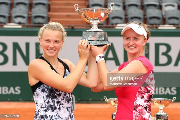 Barbora Krejcikova and Katerina Siniakova of the Czech Republic lift the trophy as they celebrate victory following the ladies doubles final against...