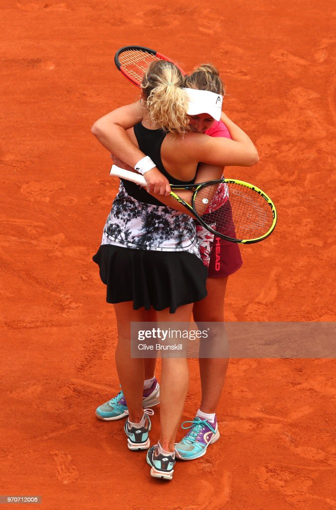 Barbora Krejcikova (Pink top) and Katerina Siniakova (White top) of the Czech Republic celebrate victory following the ladies doubles final against Eri Hozumi and Makoto Ninomiya of Japan during day fifteen of the 2018 French Open at Roland Garros on June 10, 2018 in Paris, France.