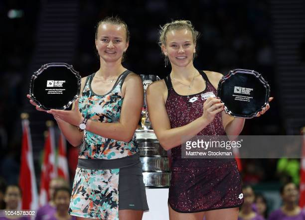 Barbora Krejcikova and Katerina Siniakova of the Czech Republic pose with their runner up trophy after their match with Timea Babos of Hungary and...