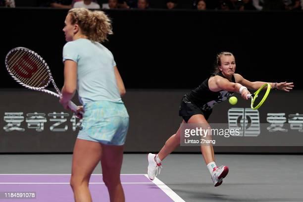 Barbora Krejcikova and Katerina Siniakova of the Czech Republic return the ball against Samantha Stosur of Australia and Zhang Shuai of China during...