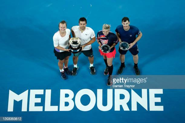 Barbora Krejcikova of Czech Republic and Nikola Mektic of Croatia pose with the championship trophy and Bethanie MattekSands of the United States and...