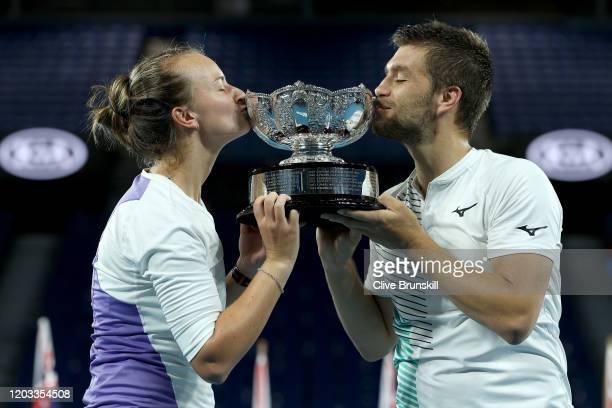 Barbora Krejcikova of Czech Republic and Nikola Mektic of Croatia kiss the championship trophy after winning their Mixed Doubles Finals match against...
