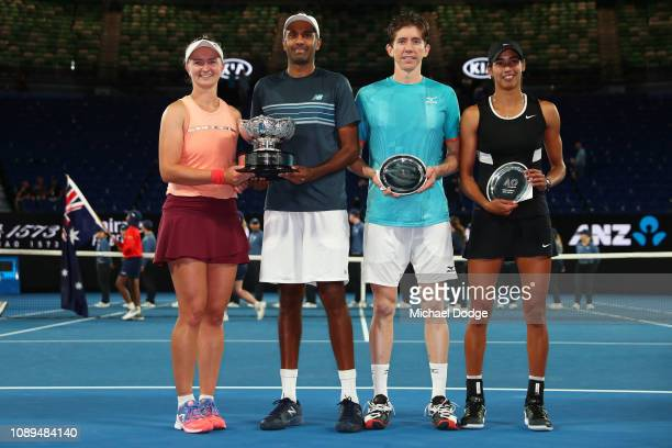 Barbora Krejcikova of Czech Republic and Rajeev Ram of the United States and Astra Sharma and JohnPatrick Smith of Australia pose with their trophies...
