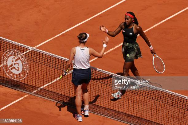 Barbora Krejcikova of Czech Republic interacts with Coco Gauff of The United States at the net after victory in the Ladies Singles Quarter-Final on...