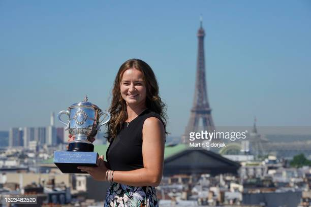 Barbora Krejcikova of Czech Republic poses on the rooftop of les Galeries Lafayettes Rue de la Chaussee d'Antin with the Suzanne Lenglen Cup...