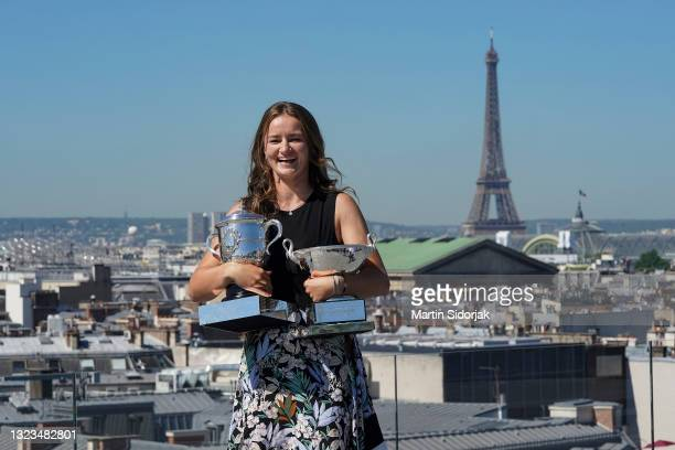 Barbora Krejcikova of Czech Republic poses on the rooftop of les Galeries Lafayettes Rue de la Chaussee d'Antin with the Suzanne Lenglen Cup as well...