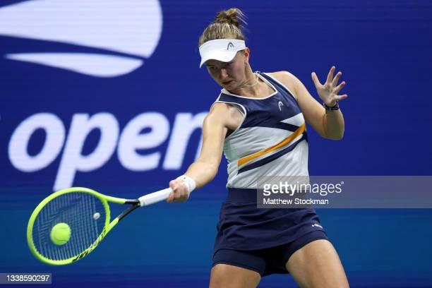 Barbora Krejcikova of Czech Republic returns the ball against Garbine Muguruza of Spain during their Women's Singles fourth round match on Day Seven...