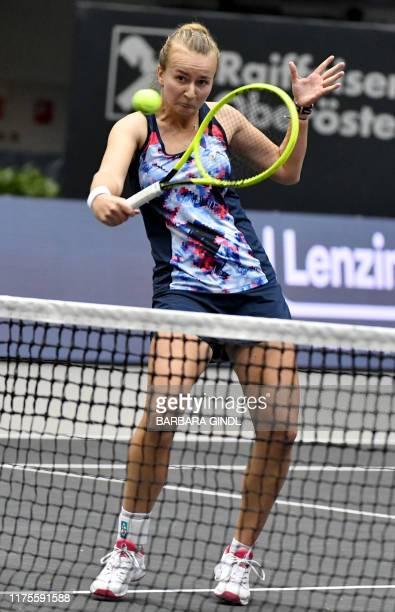 Barbora Krejcikova of Czech Republic returns the ball to Barbara Haas of Austria and Xenia Knoll of Switzerland during the WTA-Upper Austria Ladies'...