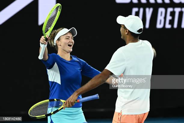 Barbora Krejcikova of the Czech Republic and Rajeev Ram of the United States celebrate winning championship point in their Mixed DoublesFinal match...