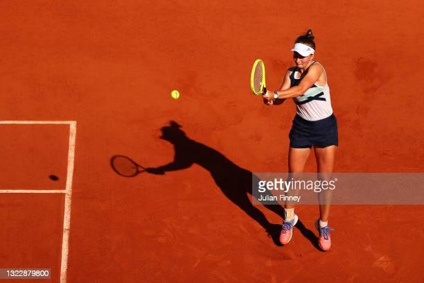 Barbora Krejcikova of The Czech Republic plays a backhand in her Semi-Final Women's Singles match against Maria Sakkari of Greece during Day Twelve...