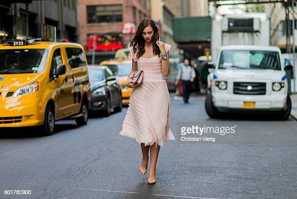 Barbora Ondrackova wearing a Beata Rajska dress Christian Louboutin heels Valentino bag outside on September 9 2016 in New York City