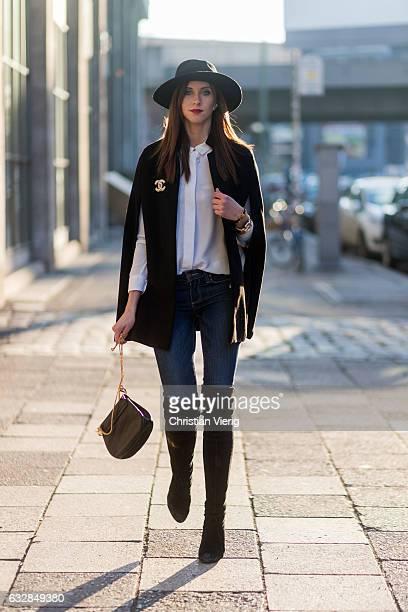 Barbora Ondrackova wearing a black cape Topshop, white button shirt Zara, navy denim jeans Paige, black overknees Stuart Weitzman, a black hat...