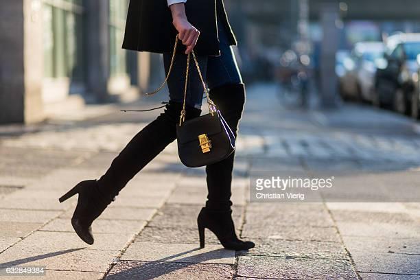 Barbora Ondrackova wearing a black cape Topshop white button shirt Zara navy denim jeans Paige black overknees Stuart Weitzman a black hat Topshop a...