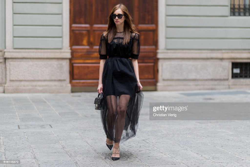 Barbora Ondrackova wearing a black dress underneath Topshop, sheer dress Domenico Cioffi, Shoes Valentino, Jimmy Choo bag, Celine sunglasses during Milan Fashion Week Fall/Winter 2017/18 on February 27, 2017 in Milan, Italy.