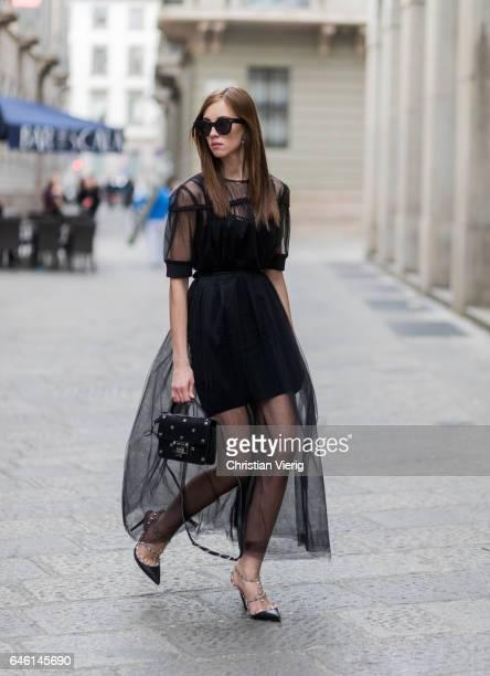 Barbora Ondrackova wearing a black dress underneath Topshop sheer dress Domenico Cioffi Shoes Valentino Jimmy Choo bag Celine sunglasses during Milan...