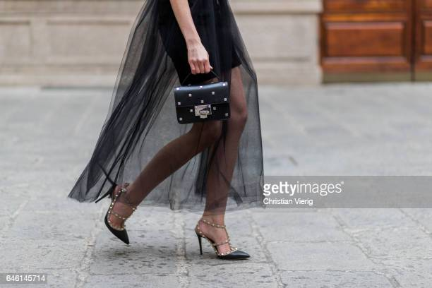 Barbora Ondrackova wearing a black dress underneath Topshop sheer dress Domenico Cioffi Shoes Valentino Jimmy Choo bag Celine sunglasses during Milan...