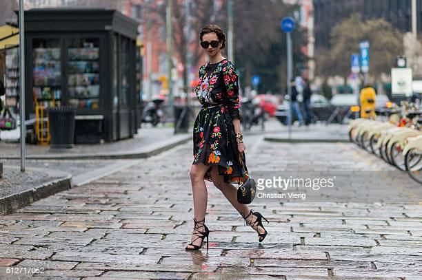 Barbora Ondrackova wearing a black Vivetta dress with a floral print Stuart Weitzman shoes Chloe bag Celine sunglasses seen outside Jil Sander during...