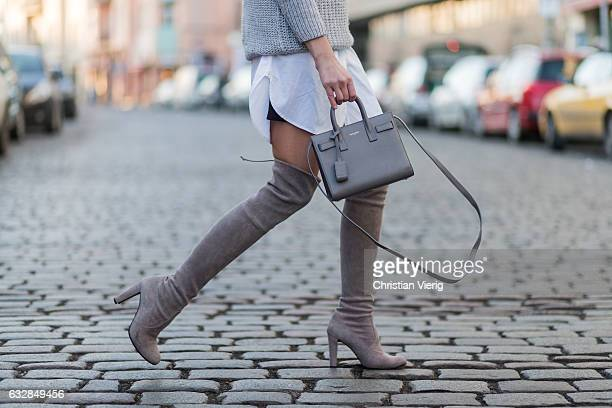 Barbora Ondrackova wearing a grey knit Topshop a white button shirt All Saints beige Stuart Weitzman boots a YSL bag Celine sunglasses on January 27...