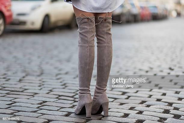 Barbora Ondrackova wearing a grey knit Topshop a white button shirt All Saints beige Stuart Weitzman boots a YSL bag Celine sunglasses on January 27...