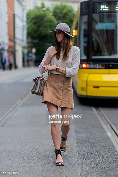 Barbora Ondrackova wearing a grey Topshop hat a Chloe bag a Zara sweater a beige Topshop skirt Isabel Marant sandals on July 18 2016 in Berlin Germany