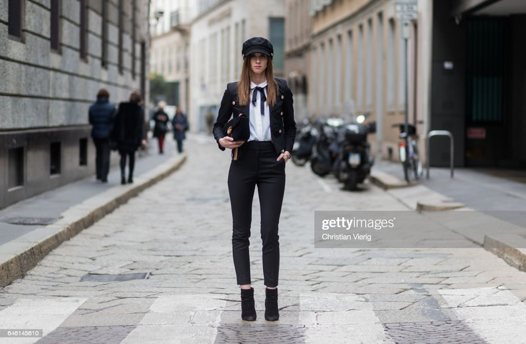 Barbora Ondrackova wearing a white blouse Zara, black blazer jacket River Island, black Zara pants, Gucci bag, Dolce & Gabbana shoes, River Island flat cap during Milan Fashion Week Fall/Winter 2017/18 on February 27, 2017 in Milan, Italy.