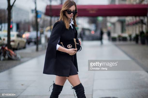 Barbora Ondrackova wearing white Topshop shirt black Asos dress black Missguided cape black Stuart Weitzman overknee boots black Gucci bag black...