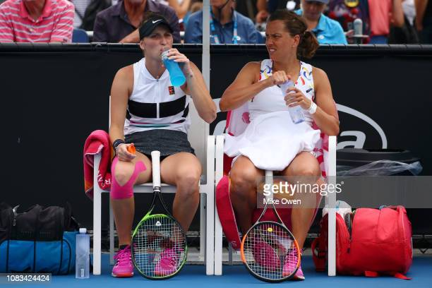 Barbora Strycova and Marketa Vondrousova of the Czech Republic rest between games in their first round doubles match against Gabriela Dabrowski of...