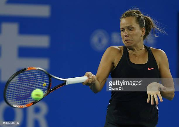Barbora Strycova of Cezch Republic returns a shot during the match against Maria Sharapova of Russia on Day 2 of 2015 Dongfeng Motor Wuhan Open at...