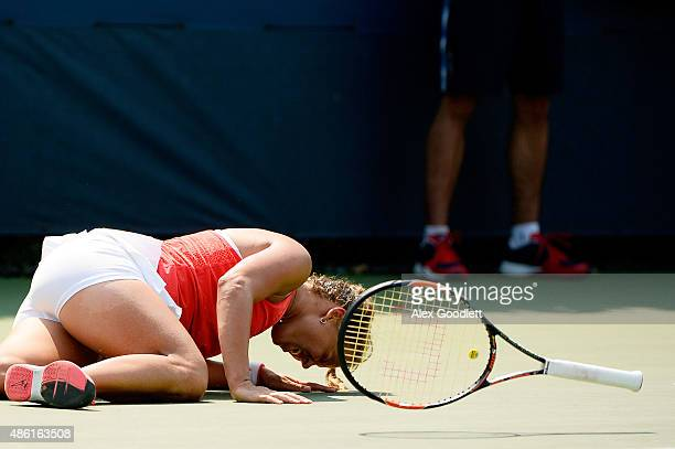 Barbora Strycova of Czech Republic falls to the ground against Timea Bacsinszky of Switzerland during their Women's Singles First Round match on Day...