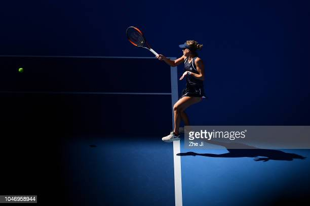 Barbora Strycova of Czech Republic hits a return against Gabriela Dabrowski of Canada and Xu Yifan of China with her teammate Andrea Sestini...