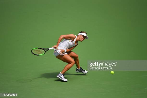 TOPSHOT Barbora Strycova of Czech Republic hits a return against Simona Halep of Romania during their second round women's singles match at the Wuhan...