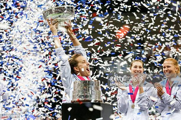 Barbora Strycova of Czech Republic lifts up the trophy as she celebrates with her teammates their win after the Fed Cup final match between Czech...