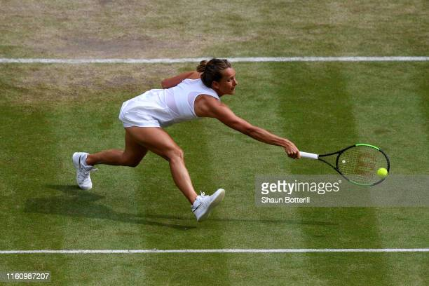 Barbora Strycova of Czech Republic stretches to play a backhand in her Ladies' Singles Quarter Final match against Johanna Konta of Great Britain...
