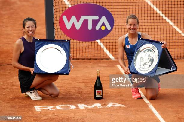 Barbora Strycova of The Czech Republic and playing partner Su-wei Hsieh of Taiwan pose with their trophies after winning their women's doubles final...
