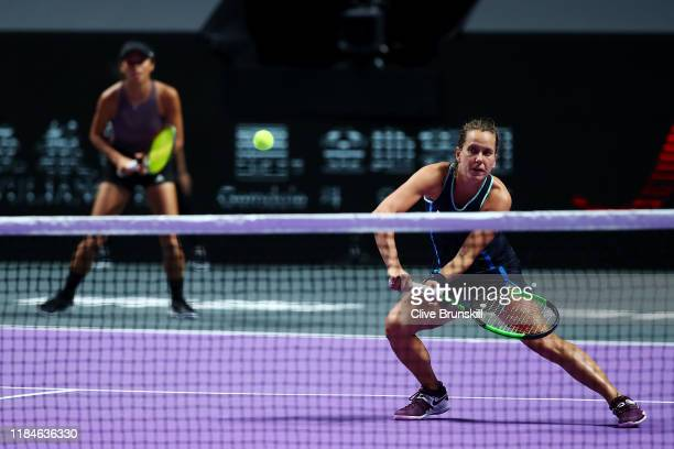 Barbora Strycova of the Czech Republic and SuWei Hsieh of Chinese Taipei return the ball against Gabriela Dabrowski of Canada and Xu Yifan of China...