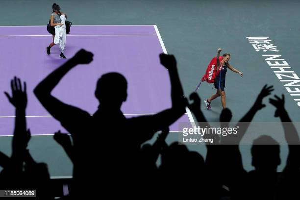 Barbora Strycova of the Czech Republic and Su-Wei Hsieh of Chinese Taipei react to the crowd as they walk off the court after their Women's Doubles...