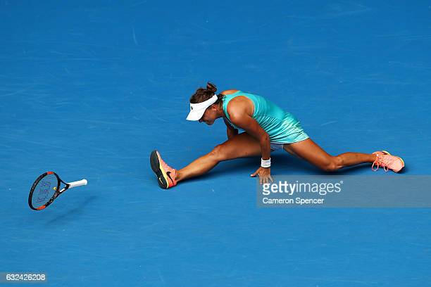 Barbora Strycova of the Czech Republic falls over in her fourth round match against Serena Williams of the United States on day eight of the 2017...