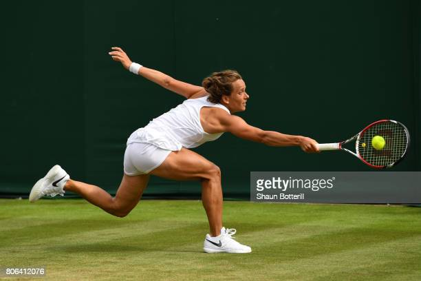Barbora Strycova of the Czech Republic stretches as she plays a backhand during the Ladies Singles first round match against Veronica Cepede Royg of...