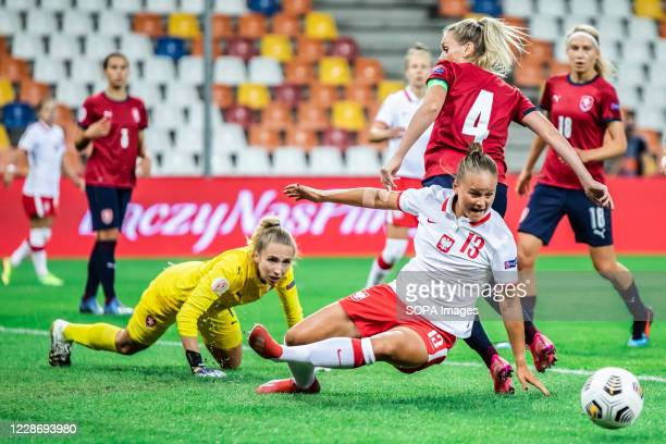 Barbora Votikova of Czech Republic and Patrycja Balcerzak of Poland are seen in action during the UEFA Women's EURO 2021 qualifying match between...