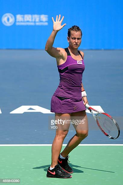 Barbora Zahlavova Strycova of Czech competes with Daniela Hantuchova of Slovakia during day 1 of the 2014 Dongfeng Motor Wuhan Open at Optics Valley...