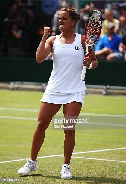Barbora Zahlavova Strycova of Czech Republic celebrates after winning the first set during her Ladies' Singles fourth round match against Caroline...