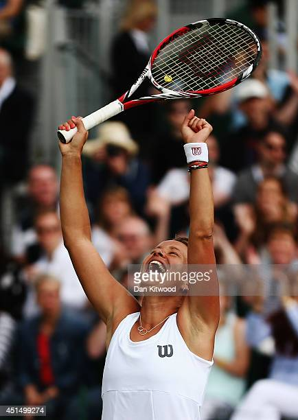 Barbora Zahlavova Strycova of Czech Republic celebrates after winning her Ladies' Singles fourth round match against Caroline Wozniacki of Denmark on...