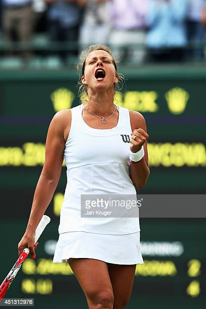 Barbora Zahlavova Strycova of Czech Republic celebrates match point as she wins the Ladies' Singles third round match against Na Li of China on day...