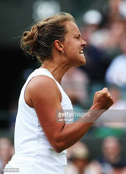 Barbora Zahlavova Strycova of Czech Republic celebrates winning the opening set during the Ladies' Singles third round match against Na Li of China...