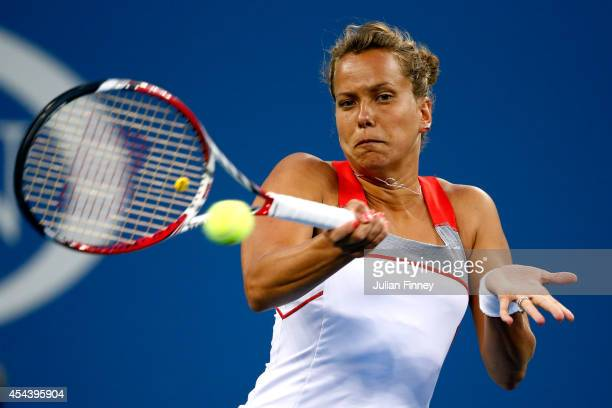Barbora Zahlavova Strycova of the Czech Republic returns a shot against Eugenie Bouchard of Canada during their women's singles third round match on...