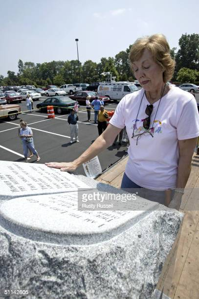 Barbra Labbous touches an inscription of the Ten Commandments on the monument which was removed from Alabama's state judicial building August 4 2004...