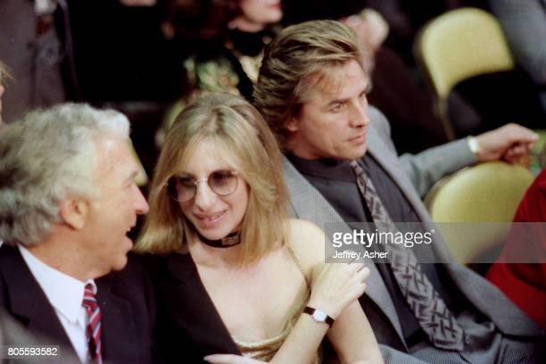 Barbra Streisand and Don Johnson ringside at Tyson vs Holmes Convention Hall in Atlantic City New Jersey January 22 1988